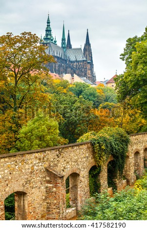 Prague autumn landscape view to saint vitus cathedral. Panorama to castle garden trees fall. - stock photo