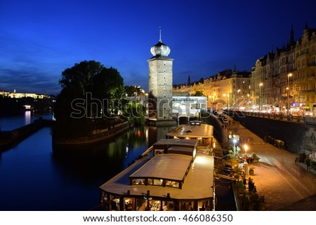 Prague by night - view on Prague Castle, Manes, boats and historical buildings around Vltava river.