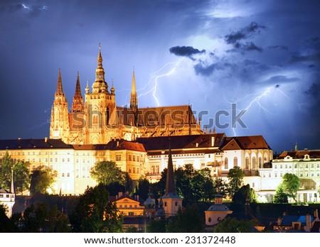 Prague castle and Charles bridge at night - stock photo