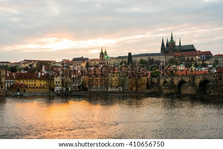 Prague Castle and St. Vitus cathedral in twilight with dramatic sky. Prague, Czech Republic - stock photo