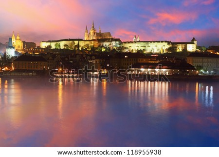 Prague Castle from river at sunrise - Czech republic - stock photo