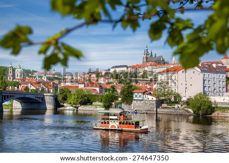 Prague Castle with boat on Vltava river in Czech Republic - stock photo