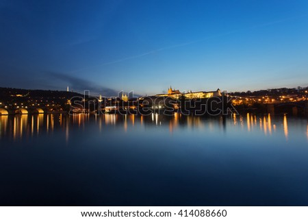 Prague city at night, Charles Bridge, Lobkowicz Palace, Hradcany and Prague Castle reflection in Vltava river. Prague, Czech Republic