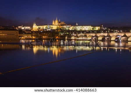 Prague city at night, Charles Bridge, Lobkowicz Palace, Hradcany and Prague Castle reflection in river. Prague, Czech Republic