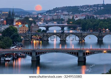 Prague cityscape and full moon, Czech republic - stock photo