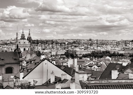 Prague cityscape seen from Hradcany district. Capital city of Czech Republic. Mala Strana district with beautiful baroque St. Nicolas Church. Black and white tone - retro monochrome color style. - stock photo