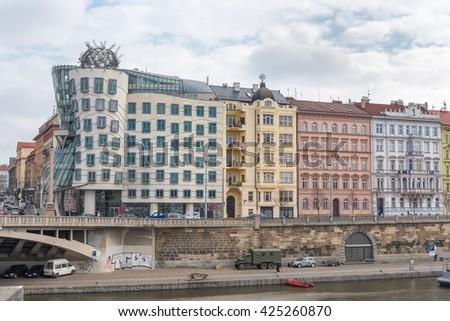 PRAGUE, CZECH - MARCH 11, 2016: River Vltava in Prague, Czech. Dancing House, Bridge, Barge and Architecture. - stock photo