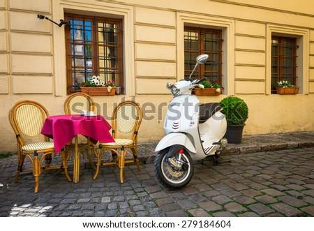 PRAGUE, CZECH REPABLIC - APRIL 22, 2015: Old Vespa parked near cafe in Prague, Czech Republic. - stock photo
