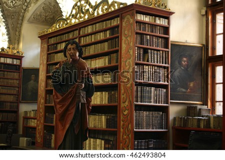 PRAGUE/CZECH REPLUBIC - DECEMBER 28: A Late-Gothic statue of St John the Evangelist at Strahov's monastery library holding a girdle-book which served as a travel bag, shown on 28-12-2013 in Prague.