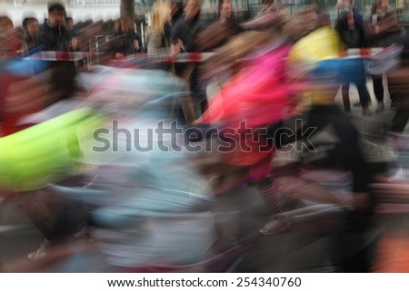 PRAGUE, CZECH REPUBLIC - APRIL 6, 2013: Athletes run the Prague international marathon in Prague, Czech Republic. - stock photo