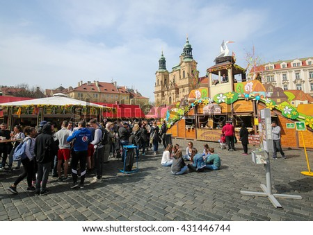 PRAGUE, CZECH REPUBLIC - APRIL 3, 2016: Easter market near St. Nicolas Church in the Old Town Square in the historic center of Prague, Czech Republic