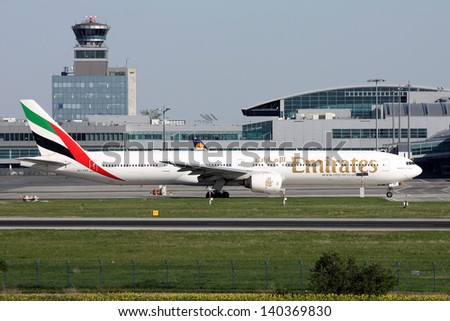 PRAGUE, CZECH REPUBLIC - APRIL 28: Emirates Airlines Boeing B777 taxiing to take-off from PRG Airport on April  28, 2012. Prague Airport is the biggest airport in the Czech Republic. - stock photo