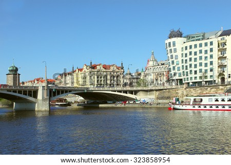 Prague, Czech Republic - April 22, 2015: Quay in the center of Prague. Boat on Vltava river near Juraskuv bridge