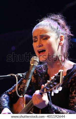 PRAGUE, CZECH REPUBLIC - APRIL 4, 2016: Singer Lenka Dusilova performs live on stage during a concert at Palac Akropolis on April 4, 2016 in Prague, Czech Republic. - stock photo