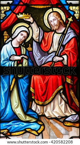 PRAGUE, CZECH REPUBLIC - APRIL 5, 2016: Stained Glass in the Basilica of Vysehrad in Prague, Czech Republic, depicting Christ placing a crown on the head of Mary as Queen of Heaven