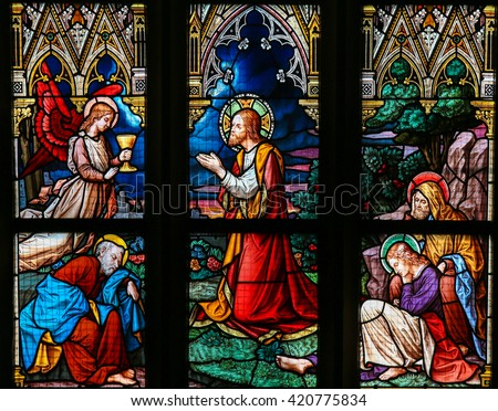 PRAGUE, CZECH REPUBLIC - APRIL 5, 2016: Stained Glass in the Basilica of Vysehrad in Prague, Czech Republic, depicting Jesus' Agony in the Garden of Gethsemane.  - stock photo