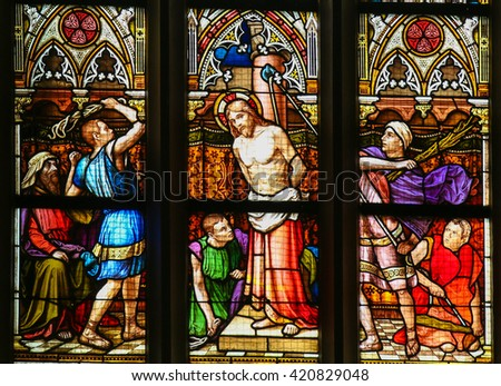 PRAGUE, CZECH REPUBLIC - APRIL 5, 2016: Stained Glass in the Basilica of Vysehrad in Prague, Czech Republic, depicting the Flagellation of Christ