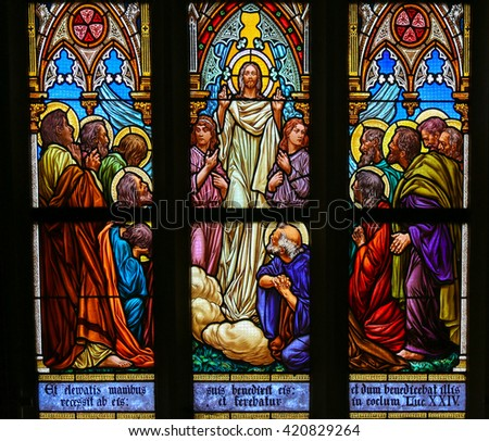PRAGUE, CZECH REPUBLIC - APRIL 5, 2016: Stained Glass in the Basilica of Vysehrad in Prague, Czech Republic, depicting Jesus speaking to his disciples - stock photo
