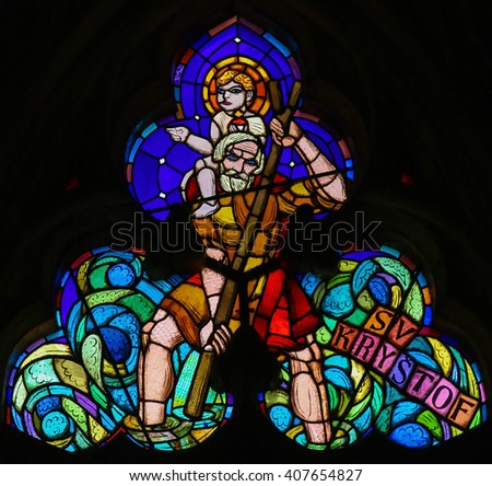 PRAGUE, CZECH REPUBLIC - APRIL 2, 2016: Stained Glass window in St. Vitus Cathedral, Prague, depicting Saint Christopher Carrying the Christ Child