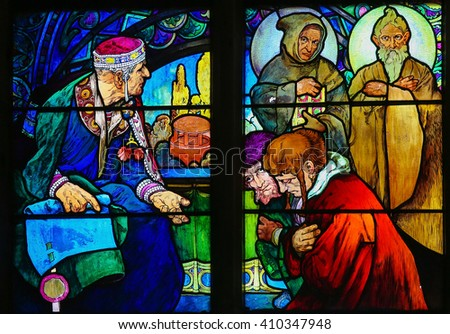 PRAGUE, CZECH REPUBLIC - APRIL 2, 2016: Stained Glass window in St. Vitus Cathedral, Prague, designed by Alphonse Mucha, depicting Saints Cyril and Methodius - stock photo