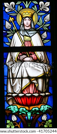 PRAGUE, CZECH REPUBLIC - APRIL 2, 2016: Stained Glass window in St. Vitus Cathedral, Prague depicting the Blessed Virgin Mary - stock photo