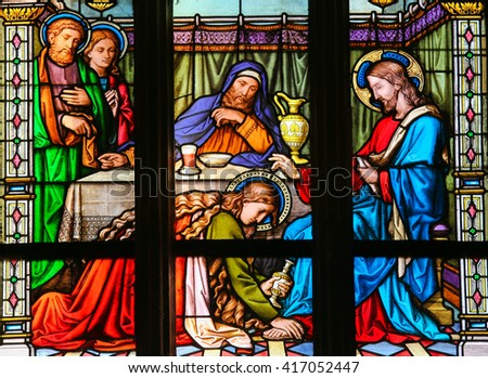 PRAGUE, CZECH REPUBLIC - APRIL 2, 2016: Stained Glass window in St. Vitus Cathedral, Prague, depicting Mary Magdalen anointing Christâ??s feet