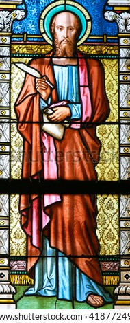 PRAGUE, CZECH REPUBLIC - APRIL 2, 2016: Stained Glass window in St. Vitus Cathedral, Prague, depicting Saint Mark the Evangelist