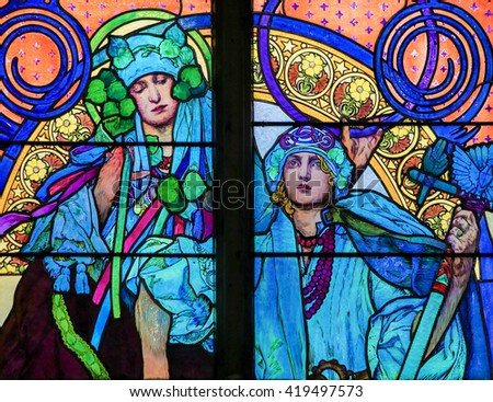 PRAGUE, CZECH REPUBLIC - APRIL 2, 2016: Stained Glass window in St. Vitus Cathedral, Prague, designed by Alphonse Mucha.