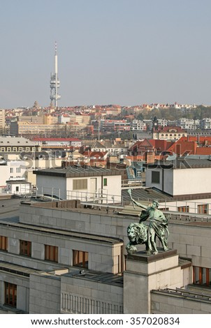 PRAGUE, CZECH REPUBLIC - APRIL 16, 2010: Statue on the top of Czech National Bank, view from Powder Tower