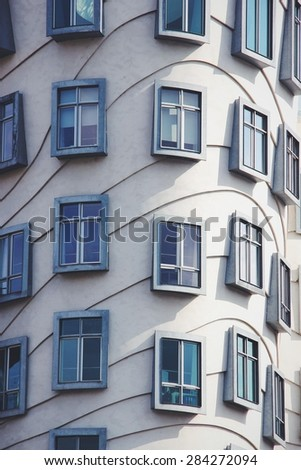 PRAGUE, CZECH REPUBLIC - APRIL 18, 2013: The detail of the Dancing House in Prague. It was designed by Canadian-American architect Frank Gehry. Gehry originally named the house Fred and Ginger. - stock photo