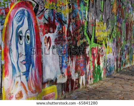 PRAGUE, CZECH REPUBLIC - APRIL 7: The Lennon Wall since the 1980s filled with John Lennon-inspired graffiti and pieces of lyrics from Beatles songs on April 7, 2009 in Prague, Czech Republic
