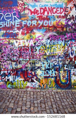 PRAGUE, CZECH REPUBLIC - APRIL 12: The Lennon Wall since the 1980s is filled with John Lennon-inspired graffiti and pieces of lyrics from Beatles songs on April 12, 2013 in Prague, Czech Republic - stock photo