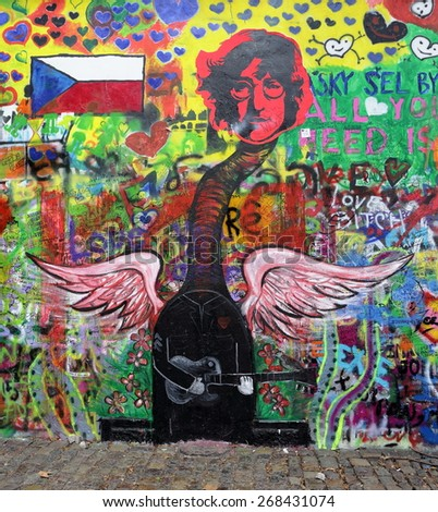 PRAGUE, CZECH REPUBLIC - APRIL 1, 2015: The Lennon Wall since the 1980s is filled with John Lennon-inspired graffiti and pieces of lyrics from Beatles songs on April 1, 2015 in Prague.