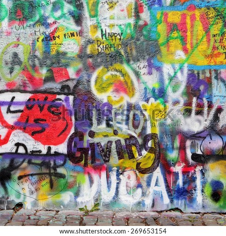 PRAGUE, CZECH REPUBLIC - APRIL 13, 2015: The Lennon Wall since the 1980s is filled with John Lennon-inspired graffiti and pieces of lyrics from Beatles songs on April 13, 2015 in Prague.
