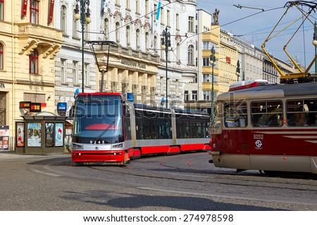 Prague, Czech Republic - April 23, 2015:  Tram at old street in Prague. Prague is the capital and largest city of the Czech Republic. - stock photo