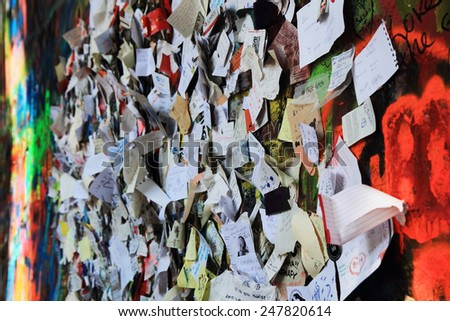 PRAGUE, CZECH REPUBLIC - AUGUST 10:The Lennon Wall since the 1980s filled with John Lennon-inspired graffiti and pieces of lyrics from Beatles songs on August 10, 2014 Prague, Czech Republic - stock photo