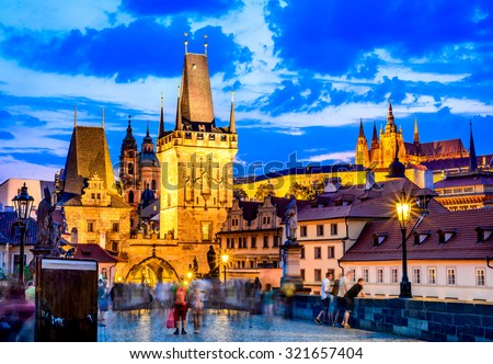 Prague, Czech Republic. Charles Bridge and Mala Strana towers, with Prague Castle (Hrad) in background. Twilight image of Bohemia capital. - stock photo
