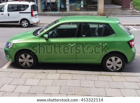 PRAGUE, CZECH REPUBLIC - CIRCA JUNE 2016: light green Skoda Fabia car parked on a street of the city centre - stock photo