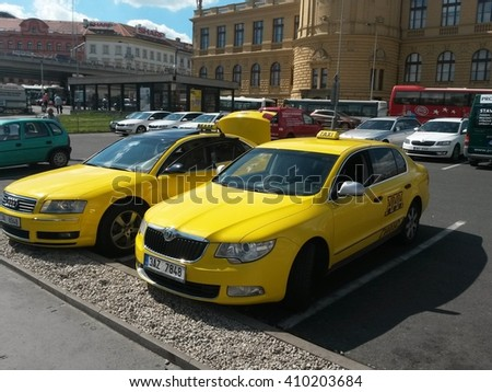 PRAGUE, CZECH REPUBLIC - CIRCA JUNE 2015: yellow taxi cars parked on a street in the city centre - stock photo