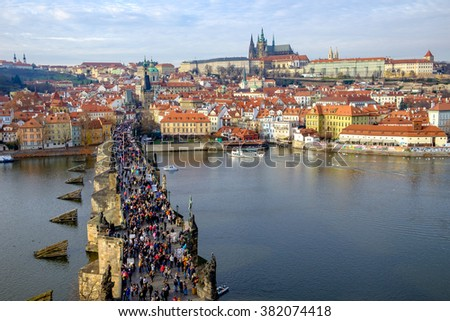 Prague, Czech Republic - 19 December 2015: Charles bridge with crowds of people and Prague castle