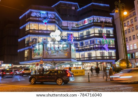 PRAGUE, CZECH REPUBLIC - DECEMBER  13, 2017: Christmas markets in front of a large decorated shopping center Kotva in Prague on the Republic square.