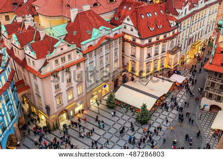 PRAGUE, CZECH REPUBLIC - DECEMBER 10, 2015: Red roofs, buildings, shops and restaurants at Staromestske Namesti in Old town of Prague, Czech Republic - capital and fifth most visited city in Europe.