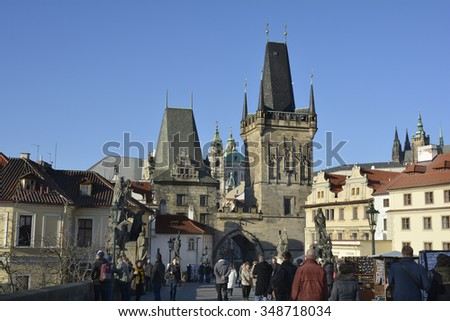 PRAGUE, CZECH REPUBLIC-DECEMBER 03: Unidentified people on Charles bridge (in Czech: Karluv Most on December 03, 2015 in Prague, Czech Republic