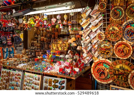 PRAGUE, CZECH REPUBLIC - DECEMBER 10, 2016: Wooden stall with decorations for winter holidays and traditional souvenirs during annual Christmas market in Old Town of Prague.