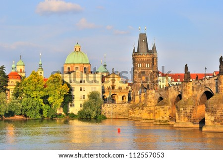 Prague, Czech Republic. Embankment of the Vltava River and the Old Town at sunset