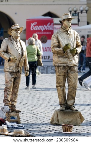 PRAGUE, CZECH REPUBLIC/EUROPE - SEPTEMBER 24 : Living statues in the Old Town Square Prague on September 24, 2014. Unidentified people. - stock photo