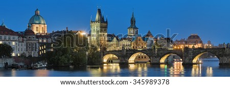 Prague, Czech Republic. Evening panorama of the Charles Bridge with dome of the Saint Francis of Assisi Church, Old Town Bridge Tower, Old Town Water Tower, dome of the National Theatre. - stock photo
