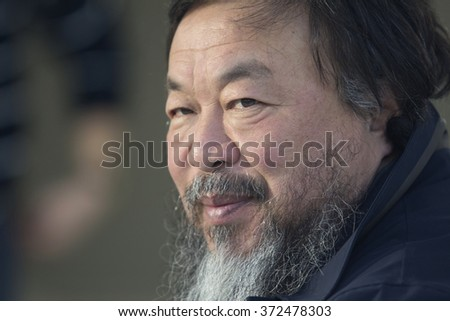 PRAGUE, CZECH REPUBLIC - FEBRUARY 5, 2016: Chinese artist Ai Weiwei  looks on during preview of his exhibition Circle of Animals / Zodiac Heads at Trade Fare Palace / the National Gallery in Prague.