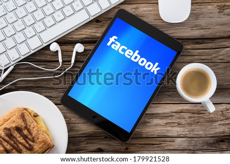 PRAGUE, CZECH REPUBLIC - FEBRUARY 20, 2014: Facebook is an online social networking service founded in February 2004 by Mark Zuckerberg with his college roommates and is now a fortune 500 company. - stock photo