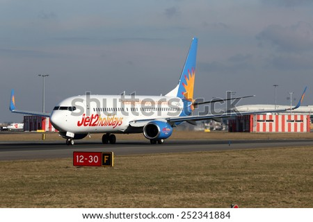 PRAGUE, CZECH REPUBLIC - FEBRUARY 05: Jet2 Holidays Boeing 737-8K5 taxis to take off from PRG Airport on February 05, 2015. Jet2 is a British low-cost airline. - stock photo